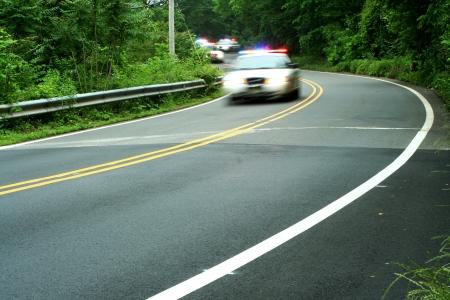 警察の車が道を運転して 写真素材