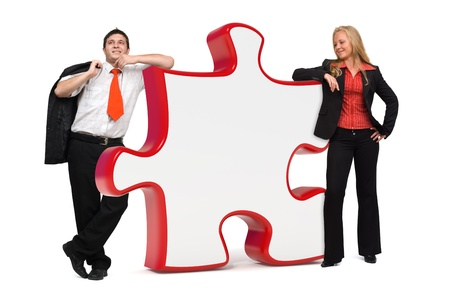 Business people standing near a big red puzzle with copyspace