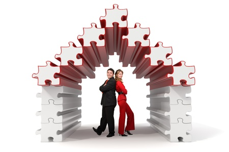 Business partners standing in a 3d rendered puzzle house - Isolated Stock Photo - 10788718