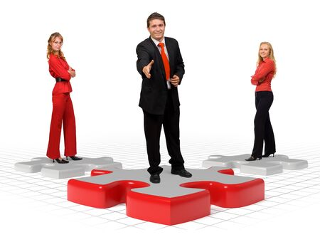 Business team standing on puzzle pieces - isolated Stock Photo - 10788727