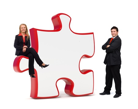 Smiling business team with an empty puzzle board - Isolated - Copyspace