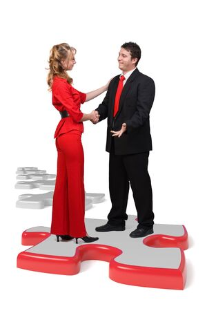Business people shaking hands on a puzzle peace - Isolated Stock Photo