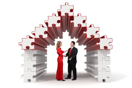 Business partners shaking hands in a 3d rendered puzzle house - Isolated Stock Photo - 10865405