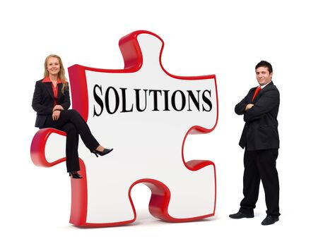 Smiling business team with a solutions puzzle board - Isolated Stock Photo - 10865394