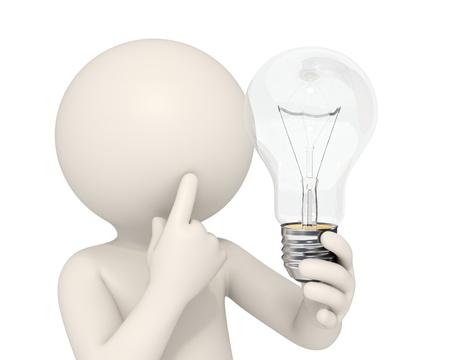 3d man holding a light bulb while thinking - Idea concept - DOF Фото со стока