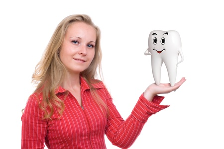 Tooth speaking on blonde womans hand isolated Stock Photo - 11688350