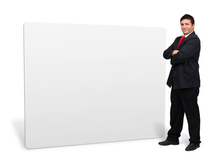 man presenting: Young confident business man presenting a white empty board with copyspace