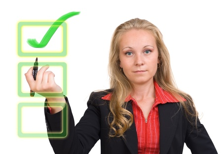 Young business woman with a virtual green check mark on a virtual monitor photo