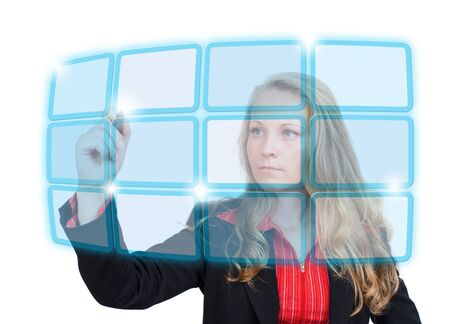 human touch: Young business woman pointing to a blue virtual screen with empty boxes