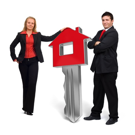 Business people presenting a 3d rendered red home key Stock Photo - 13082130
