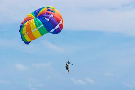 parasailing: playing Parasailing  summer with the beautiful blue sky