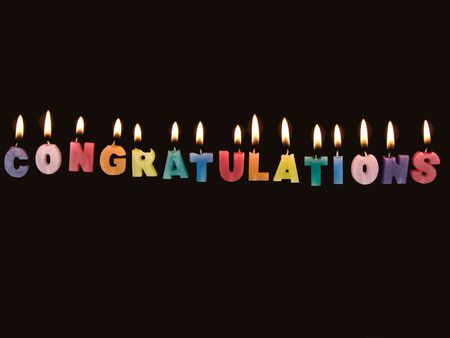 Wax candles spelling Congratulations Stock Photo