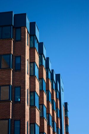 A modern office building against a blue sky Stock Photo