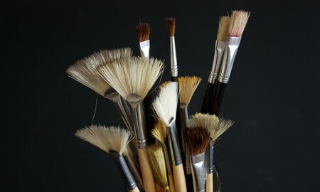 Paintbrushes close up on a black background Stock Photo