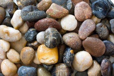 Natural pebbles with raindrops