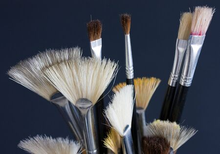Artistists brushes on a grey background