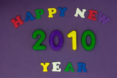 New year greeting card with bright coloured letters