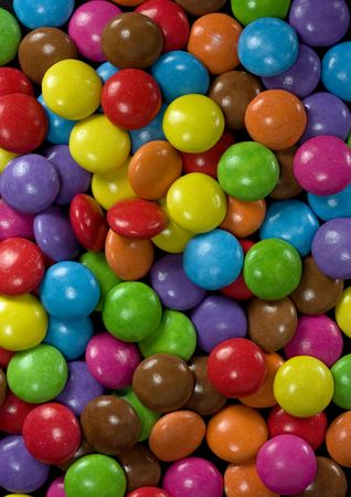 Brightly colored chocolate beans full frame