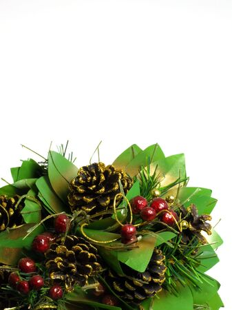 Pine cones and red berry floral display on white Stock Photo