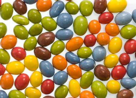 Candy coated chocolate peanuts background full frame