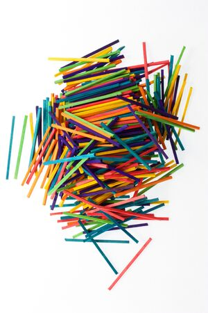 A pile of bright coloured sticks on white