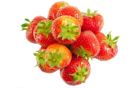 Heap of ripe juicy strawberries on white