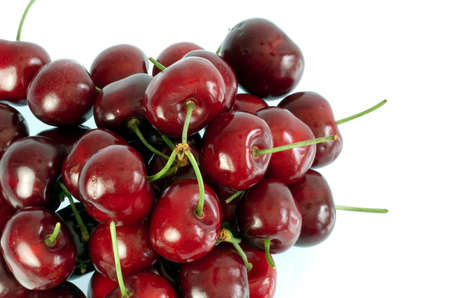 Delicious ripe red cherries isolated on white Stock Photo