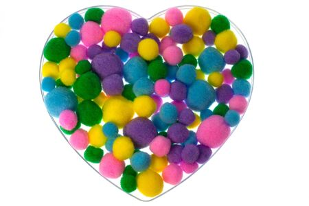 Heart shape filled with colored fluffy balls