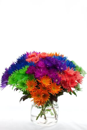 Bouquet of fresh flowers in very bright colours with vase