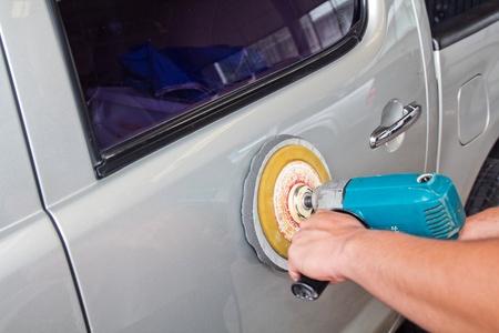 Car care with power buffer machine .  photo