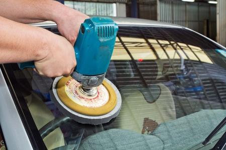 buff: Car Glass polishing with power buffer machine.  Stock Photo