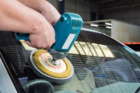buffing: Car Glass polishing with power buffer machine.