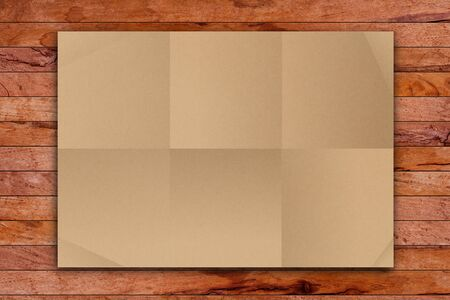 paper fold: Empty Brown Crumpled paper on wood table  Stock Photo