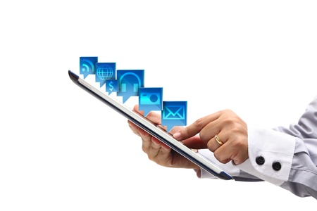 Business woman hands are holding and point on Tablet PC with cloud of colorful application icons  photo
