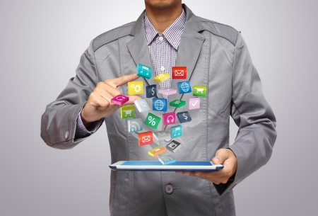 application icons:  Business man use tablet pc with colorful application icons  Stock Photo