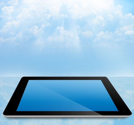 palmtop computer:  tablet pc computer with cloud sky  Stock Photo