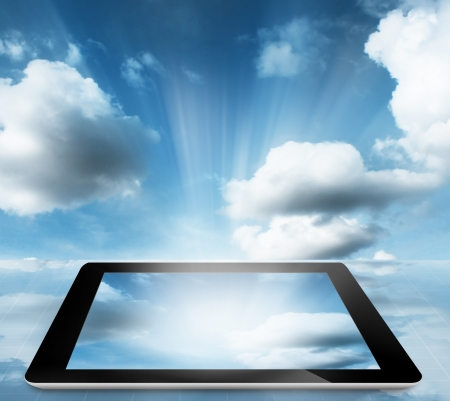 electronic device:  tablet pc computer with cloud sky  Stock Photo
