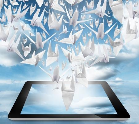 graphics tablet: Origami Birds in flight on tablet pc computer