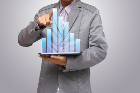 Businessmen, hand pointing on touch screen graph on a tablet Stock Photo - 14555895