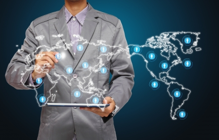 erp: business man hand point to virtual business network process diagram, with on a tablet pc  Stock Photo