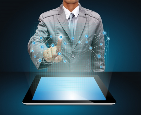business man hand point to virtual business network process diagram, with on a tablet pc  photo
