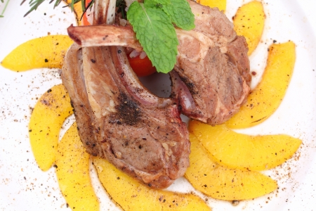 Grilled rib lamb black pepper with souse .  photo
