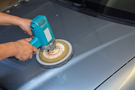 Polishing the car  with power buffer machine   CAR CARE images closeup Useful as background for design-works   photo