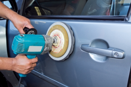 car polish: Polishing the car  with power buffer machine   CAR CARE images closeup Useful as background for design-works