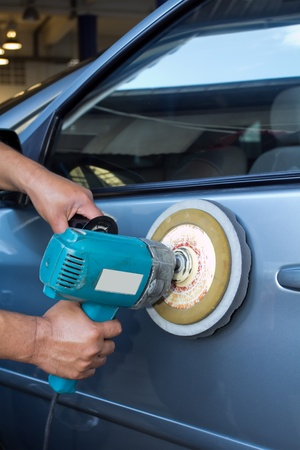 buffing: Polishing the car  with power buffer machine   CAR CARE images closeup Useful as background for design-works