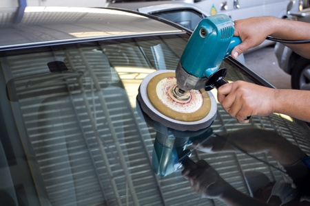 Car Glass polishing with power buffer machine  CAR CARE images  closeup Useful as background for design-works   photo