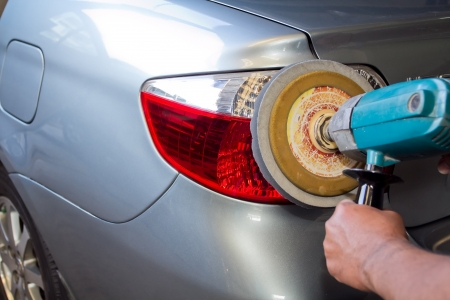 burnish: Car tail light with power buffer machine at service station - a series of CAR CARE images