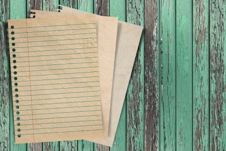 Paper texture - brown paper sheet on wood background  Stock Photo - 16850796