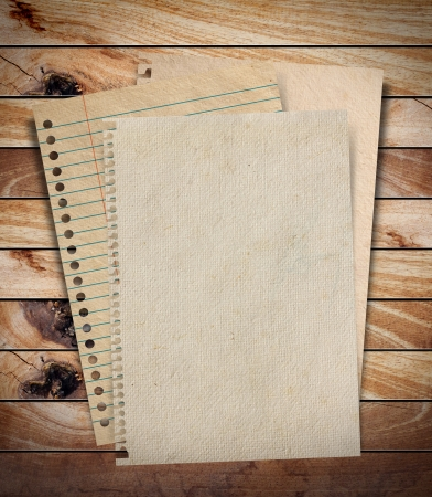 Paper texture - brown paper sheet on wood background  photo
