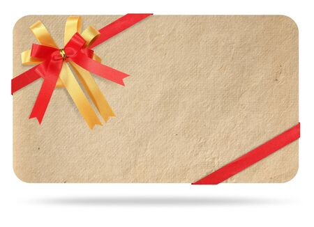 Blank gift card tied with a bow of red ribbon. Isolated on white, with save paths for design work  photo